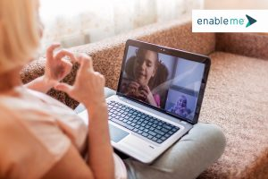 two people practice social distancing with a video call